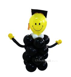 Una graciosa figura con globos para decorar tu fiesta graduación, de blog.fiestafacil.com / A fun balloon figure to decorate your graduation party, from blog.fiestafacil.com