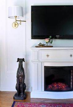 Moulding / Swing Arm Sconce / TV over Fireplace