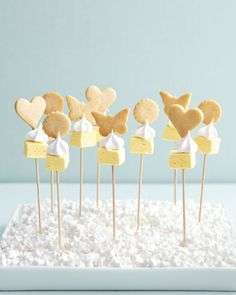 Lemon-Meringue Cookie Kebabs  This trio of shortbread cookies, meringue kisses, and lemon marshmallows is a riff on the tangy pie and is meant to be eaten in one tasty bite. To make them, bake shortbread onto sticks, and add the meringue and marshmallows once they've cooled. For a heavenly presentation, line a serving tray with a sheet of Styrofoam, poke the finished skewers through so they stand upright, and cover with a layer of candy. Try Economy Candy's white stars.  ~ Martha S