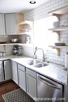 Open shelves under raised kitchen cabinets. | gracelaced.com