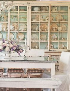 Love the tradition of displaying dishes in glass cabinets