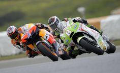 Pramac Racing Team's Spanish rider Hector Barbera (R) rides closeto  Repsol Honda Team's Australian Casey Stoner  during the MotoGP free practice 2 of the Portuguese Grand Prix in Estoril, outskirts of Lisbon, on May 4, 2012.