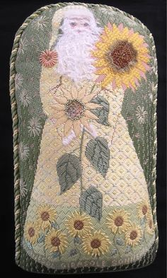 Sunflower Santa stitched by Gail Sirna - After a visit to a Van Gogh exhibit in Chicago I became obsessed with sunflowers, and this was one of my resulting designs.