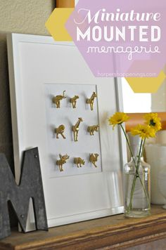 miniature mounted menagerie from Harper's Happenings. Would be adorable in a kiddo's room. Tutorial here: http://www.harpershappenings.com/2012/09/11/miniature-mounted-menagerie-also-known-as-im-obsessed-with-tiny-plastic-animals/