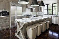 Love the X supports at the ends of this marble kitchen island