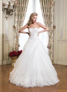 Justin Alexander wedding dress.  Tulle, beading over satin ball gown embellished with a strapless neckline