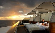 """Sleeping on deck aboard """"The World"""" cruise at sea."""