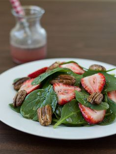 Fresh spinach, sweet strawberries, toasted pecans, and a light, poppy seed dressing | Strawberry Pecan Spinach Salad | Culinary Hill