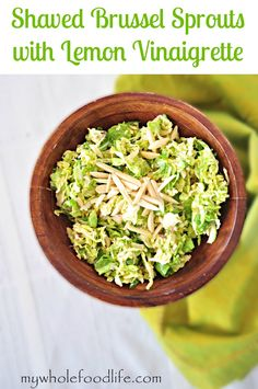 The best salad ever.  Shaved Brussel Sprouts with a Lemon Vinaigrette.  So good and very easy to make! #vegan #glutenfree #paleo #healthy #salads