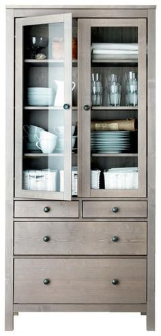 On the wall just outside the kitchen for crystal and pretty dishes?  hemnes glass door cabinet for dishes