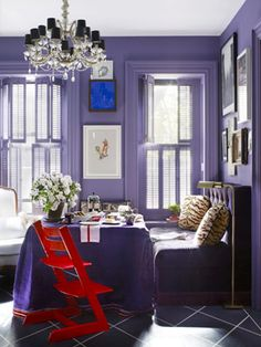 Purple dining room, red chair