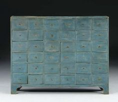 A POWDER-BLUE PAINTED APOTHECARY CABINET   American, 19th Century   45¾ in. high, 58½ in. wide, 9¾ in. deep