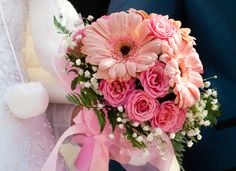 Gerber Daisy wedding bouquet with roses and baby's breath. I really like this, bit it'd have to be less pink