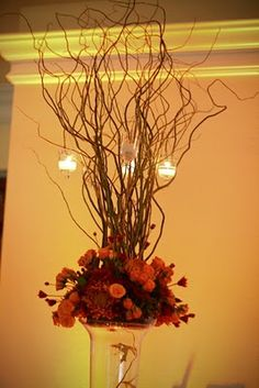 autumn centerpieces - don't like the floral part, but shows something unique with the sticks