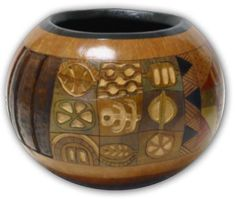 "Contemporary Sampler  Round bowl with woodburning and carving.  Oil and acrylic paint  Approx.6""H x 7""W"