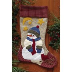 The Snowman Stocking Felt Applique Kit is a quality woolfelt stocking kit from Rachel's of Greenfield. Kit includes complete patterns & illustrated instructions, fabric for stocking trim, felt for stocking & applique, and embroidery floss & buttons for embellishments.  All of the materials you need to make this delightful felt Christmas stocking for the holidays!