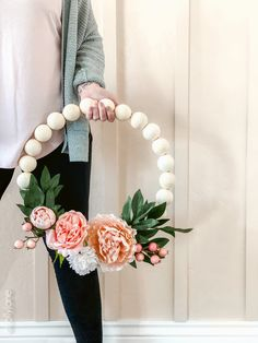 Wood Bead Wreath with Florals that perfect for spring or any time of year! EASY to make for DIYers of any level, click through for the simple how-to! #wreath #wreathdiy #diywreath #springwreath #wreathsofinstagram #diyspringdecor #springdecor #woodbeadwreath