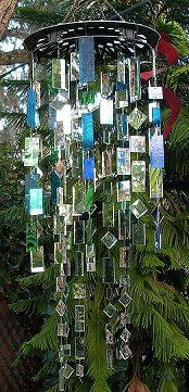 stained glass windchime hanging from hubcap.