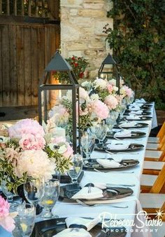 Lush pink and white arrangements interspersed with rustic lanterns | by Gavita Flora #Holman #Ranch #wedding #flowers
