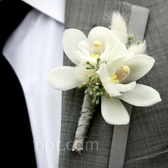 Boutonniere of mini cymbidium orchids, seeded eucalyptus and bunny tail grass.