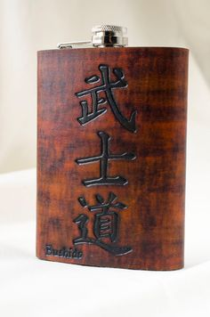 Bushido - Japanese Calligraphy - Way of the Warrior Hand Carved Leather Flask 8oz. $39.00, via Etsy.
