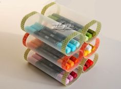 LW Designs: Recycled Blendability Caddy.  She used Crystal Light containers & glued them together to make a marker holder.