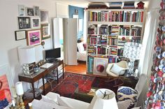 Large shelving unit filled with books: storage and a dividing wall
