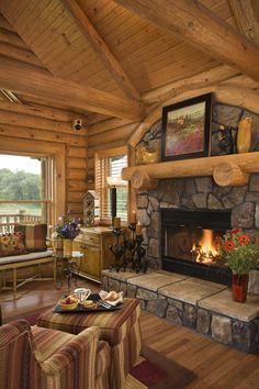 ♥ this log home and stone fireplace.