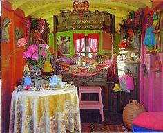restored gypsy caravan. The use of colour and pattern is invigorating and intoxicating. I LOVE IT!
