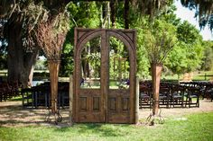 Outdoor Love: a stunning wood arch door and tall grapevine arrangements make quite an entrance | Soolip Wedding