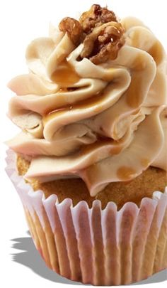 Walnut Sugar Maple  Maple walnut cake topped with maple buttercream frosting and candied walnuts.
