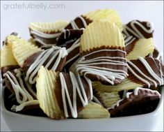 Sweet & Salty Chocolate Chips: Ruffles potato chips,   chocolate candy coating, white chocolate or vanilla candy coating.   Get a bag of Ruffles potato chips and some chocolate candy coating (Almond Bark or candy melts).  Melt the chocolate and dip the potato chips. Lay the chips on waxed paper to dry.  Melt some vanilla candy coating and drizzle across the top.