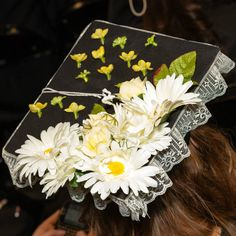 FIDM Graduates decorate their mortar boards for the 2012 FIDM Graduation Ceremony, held at the Staples Center in Downtown Los Angeles.