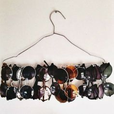 Hang sunglasses from a hanger.