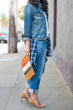 Blogger Crystalin Marie layers her Gap denim jacket over a white tee for a fall day.