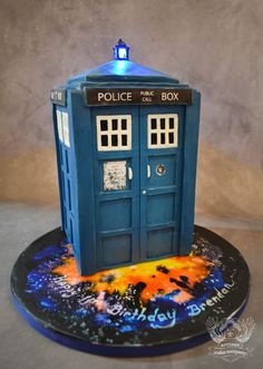 Step by step instructions for making a Tardis cake with a working light on top!