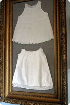 framing vintage baby clothes...