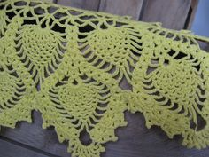 I'm wowed be the work that goes into this vintage work! Wish I had that patience  Yellow Crochet Pineapple and Flower Table Linen Doily. $6.00, via Etsy.