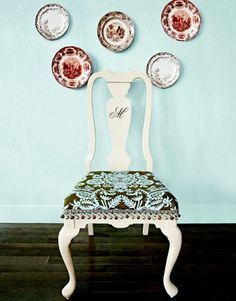 This dining room chair gets a boost with paint, fabric, and dressmaker details, all for $53.
