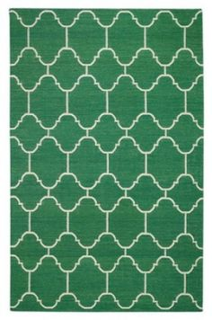 Turn up the volume in your kitchen or dining room with a bold injection of color. Rugs are a great way to make a statement without the commitment of a installing new flooring. We especially love this emerald trellis pattern for perking up a neutral space.  #ProSourceFloors