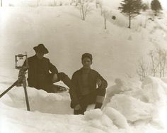 Two surveyors working in deep snow in Upper Michigan in the early 1900's.