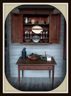 colonial style cabinet and table, something like this for outdoor dinners yes :)