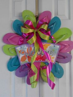 Flip Flop Wreath. $40.00, via Etsy.  Watch for them to go on sale end of season, or pick them up now at Dollar Tree or JC Penny's for a $1.00, look liek about six pairs is all you need.