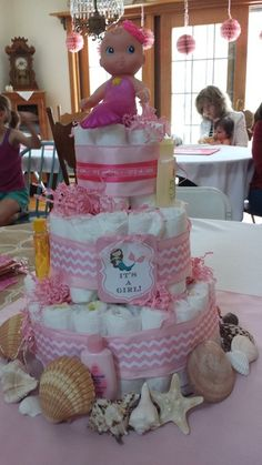 Diaper cake at a Mermaid Baby Girl Baby Shower. See more party ideas at CatchMyParty.com