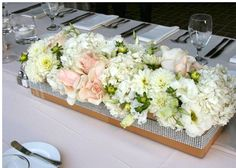 low centerpieces with peach and ivory floral