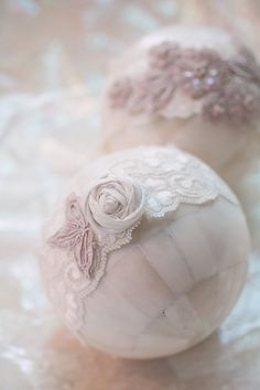 We've seen these decorative balls around - but never thought about gussying them up like this! Pretty cute! Photography by kristinvining.com