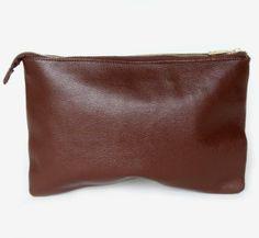 A beautiful and sturdy clutch with a gold zipper