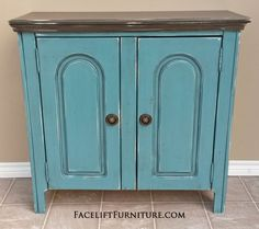 Cabinet in Sea Blue with Dark Brown top. Black Glaze, with distressing revealing white primer. Inside double shelf area in Sea Blue. Antique pulls. From Facelift Furniture's Hutches, Cabinets & Buffets collection. buffet collect, cabinet, sea blue