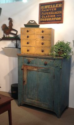Country Treasures...blue jelly cupboard with mustard apothecary chest.