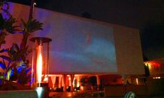 Beverly Hilton swimminng pool with Endless Summer projected on the wall on a summer night... relaxation!